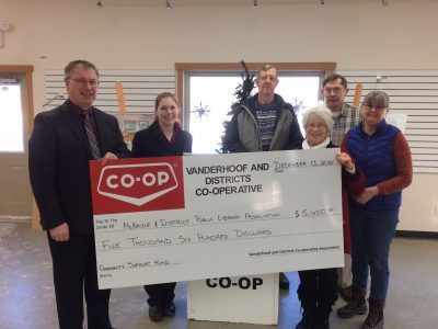 Allan and Renee from the Vanderhoof Co-op present Library Board members with a great big cheque!